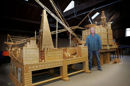 David stands proudly beside his matchstick model of the Brent Bravo oil rig