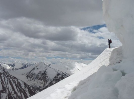 View from the summit: Neal Gwynne admires the scenery and looks for a way through the cornice on 'the Yak's back', en route to the first of Koh-e-Khar's 'donkey-ears' twin peaks